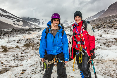Professor Regine Hock, a glaciologist with UAF's Geophysical Institute, and Tristan Weiss, a research technician with the Institute of Northern Engineering, pose during a research field trip to the Jarvis Glacier in the eastern Alaska Range.  Filename: AAR-14-4256-481.jpg