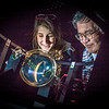 """Physics major Haley Nelson, left, and Stanley Edwin experiment with a device that creates an artificial aurora borealis in a Reichardt Building lab.  <div class=""""ss-paypal-button"""">Filename: AAR-13-4009-71.jpg</div><div class=""""ss-paypal-button-end"""" style=""""""""></div>"""