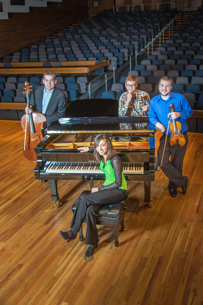 "From left to right, Bryant Hopkins, Ani Gyulamiryan, Trevor Adams and Franz Felkl performed as a quartet during the 2013 UAF Scholarship Breakfast.  <div class=""ss-paypal-button"">Filename: AAR-13-3764-75.jpg</div><div class=""ss-paypal-button-end"" style=""""></div>"