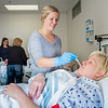 "Sarah Mergen practices taking the temperature of fellow student Mollie Egger during an exercise in their nurse aide training program at UAF's Community and Technical College.  <div class=""ss-paypal-button"">Filename: AAR-12-3548-069.jpg</div><div class=""ss-paypal-button-end"" style=""""></div>"
