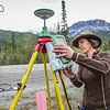 "Associate professor Margaret Darrow installs a GPS tracking module along the Dalton Highway about 225 miles north of Fairbanks. Darrow and a team of state geologists are tracking movement on a series of frozen debris lobes which have appeared along the Dietrich River valley in the southern Brooks Range, which could threaten the highway and the nearby trans-Alaska pipeline.  <div class=""ss-paypal-button"">Filename: AAR-14-4214-12.jpg</div><div class=""ss-paypal-button-end""></div>"