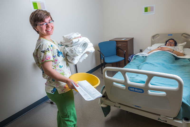 "Kris Redd, left, and Nani Pule alternate bed changing techniques during an exercise in CTC's nursing assistant training at the program's facility on Barnette Street in downtown Fairbanks.  <div class=""ss-paypal-button"">Filename: AAR-16-4873-271.jpg</div><div class=""ss-paypal-button-end""></div>"