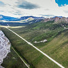 "This photo shows a couple of several frozen debris lobes which are moving at various speeds down the hillsides along the Dietrich River valley in the southern Brooks Range, posing a serious threat to the Dalton Highway and Trans-Alaska Pipeline.  <div class=""ss-paypal-button"">Filename: AAR-14-4219-112.jpg</div><div class=""ss-paypal-button-end""></div>"