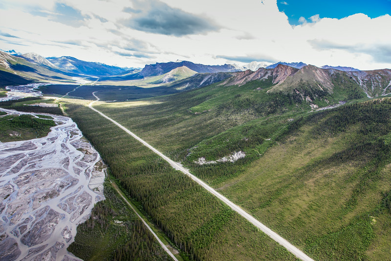 """This photo shows a couple of several frozen debris lobes which are moving at various speeds down the hillsides along the Dietrich River valley in the southern Brooks Range, posing a serious threat to the Dalton Highway and Trans-Alaska Pipeline.  <div class=""""ss-paypal-button"""">Filename: AAR-14-4219-112.jpg</div><div class=""""ss-paypal-button-end""""></div>"""