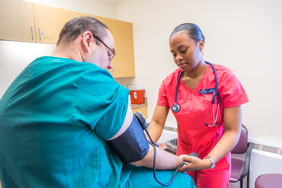 CTC medical assisting students Millicent Flannel, right, and Greg Parker alternate taking each other's vital signs during a training exercise at the program's facility on Barnette Street in downtown Fairbanks.  Filename: AAR-16-4873-313.jpg