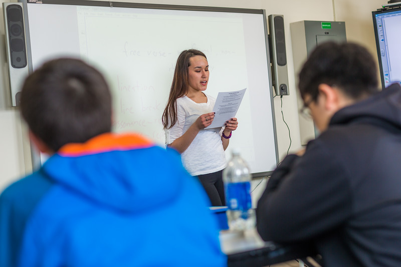 """Jesslyn McGowan from Bethel presents to her English class at UAF's Kuskokwim Campus in Bethel.  <div class=""""ss-paypal-button"""">Filename: AAR-16-4859-239.jpg</div><div class=""""ss-paypal-button-end""""></div>"""