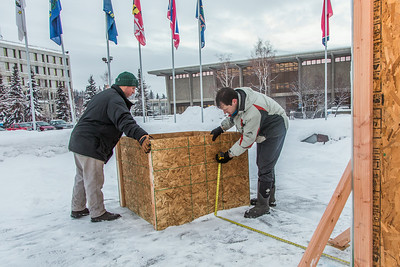 Engineering majors Tripp Collier, left, and Andy Chamberlain measure placement for the forms used to hold the foundation during initial contruction of the 2014 ice arch, a tradition on the UAF campus for more than 50 years.  Filename: AAR-14-4031-45.jpg