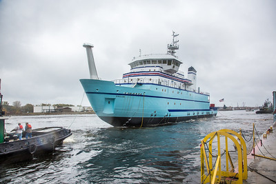 The R/V Sikuliaq comes to rest in the Menominee River seconds after its launch at the Marinette Marine Corp. in Marinette, Wisc.  Filename: AAR-12-3594-147.jpg