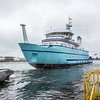 """The R/V Sikuliaq comes to rest in the Menominee River seconds after its launch at the Marinette Marine Corp. in Marinette, Wisc.  <div class=""""ss-paypal-button"""">Filename: AAR-12-3594-147.jpg</div><div class=""""ss-paypal-button-end"""" style=""""""""></div>"""
