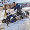 "Engineering major Isaac Thompson drives the electric snowmachine he and other members of his team helped modify into the Duckering Building after its return to campus after claiming the top prize in the SAE Clean Showmobile Challenge in Houghton, Mich.  <div class=""ss-paypal-button"">Filename: AAR-12-3337-42.jpg</div><div class=""ss-paypal-button-end"" style=""""></div>"