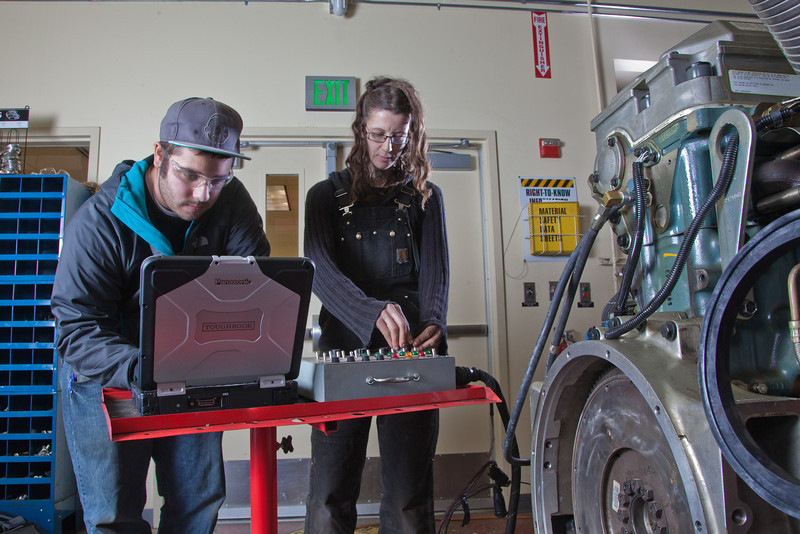 """CTC students Dayson Higgins and Missi Hacker run diagnostics in the diesel mechanics lab at the Hutchison Institute of Technology.  <div class=""""ss-paypal-button"""">Filename: AAR-12-3312-012.jpg</div><div class=""""ss-paypal-button-end"""" style=""""""""></div>"""