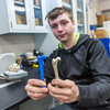 "Dillingham High School student Max Bennett displays a bone and an exact duplicate from a fetus taken from the womb of a pregnant Orca that washed ashore near Dillingham in Alaska's Bristol Bay a few years ago. Bennett has been earning high school credit through a cooperative agreement with UAF's Bristol Bay Campus to scan the whale's bones with a 3-D scanner and recreate its skeleton using a 3-D printer.  <div class=""ss-paypal-button"">Filename: AAR-16-4860-399.jpg</div><div class=""ss-paypal-button-end""></div>"