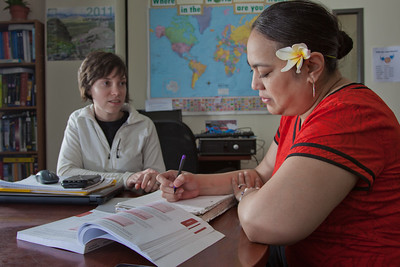 Ginny Redmond, left, director of UAF's Student Support Services, works with Kaneyo Hirata during a tutoring session in their Gruening Building office.  Filename: AAR-12-3285-092.jpg
