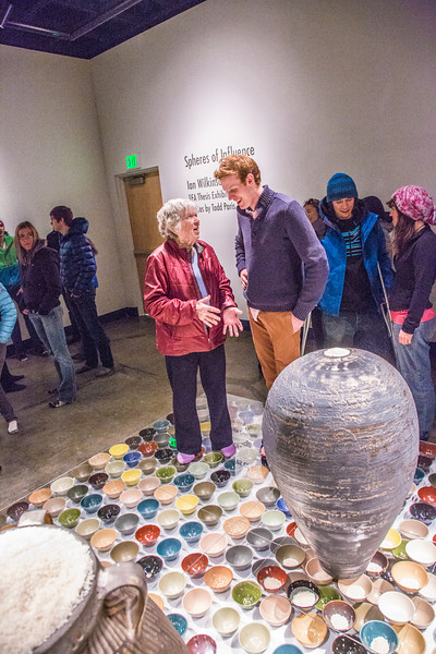 "Art major Ian Wilkinson visits with patrons during the opening reception of his BFA thesis in the gallery of the UAF Fine Arts Complex.  <div class=""ss-paypal-button"">Filename: AAR-13-3780-395.jpg</div><div class=""ss-paypal-button-end"" style=""""></div>"