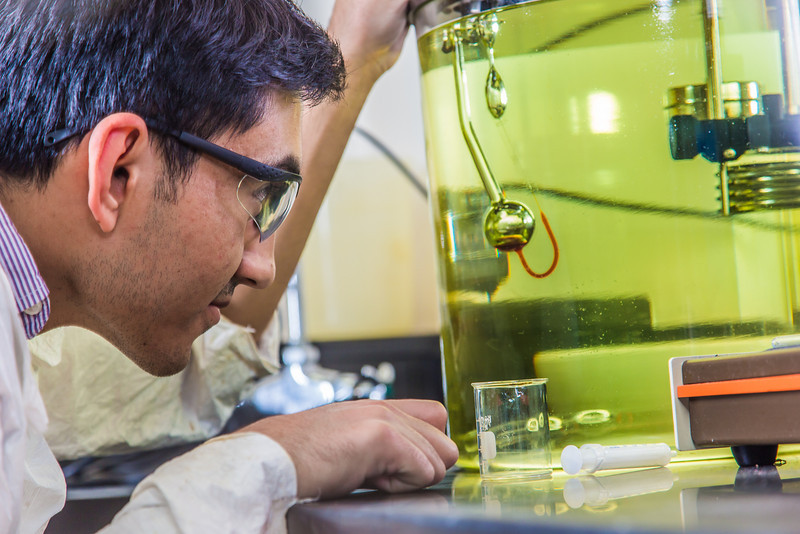 """Graduate student Behnam Zanganeh sets up apparatus for a procedure in UAF's Petroleum Development Lab in the Duckering Building.  <div class=""""ss-paypal-button"""">Filename: AAR-13-3918-199.jpg</div><div class=""""ss-paypal-button-end"""" style=""""""""></div>"""