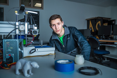 Isaiah Ramirez keeps watch as his design project goes from concept to reality in UAF's Community and Technical College's 3-D print lab in downtown Fairbanks.  Filename: AAR-16-4857-081.jpg