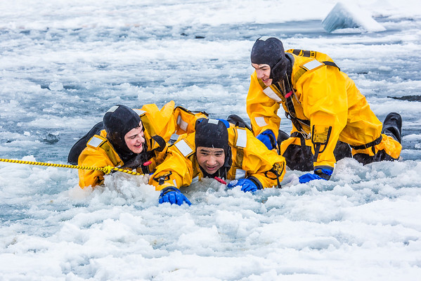 """Maxwell Delzer, left, Jordan Sanchez, and Joshua Stern practice cold-water rescue techniques this morning with the University of Alaska Fairbanks Fire Department.  <div class=""""ss-paypal-button"""">Filename: AAR-13-3797-87.jpg</div><div class=""""ss-paypal-button-end"""" style=""""""""></div>"""