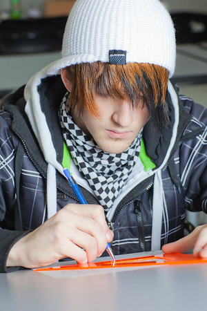 Jacob Carter works through his weekly drafting assignment at UAF's Community and Technical College.  Filename: AAR-11-3221-82.jpg