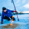 "Research Associate Professor Katey Walter Anthony inspects flaming methane gas seeping from a hole in the ice on the surface of a pond on the UAF campus. The naturally occurring phenomenon is made worse by thawing permafrost and increased plant decay caused by global warming.  <div class=""ss-paypal-button"">Filename: AAR-16-4815-36.jpg</div><div class=""ss-paypal-button-end""></div>"