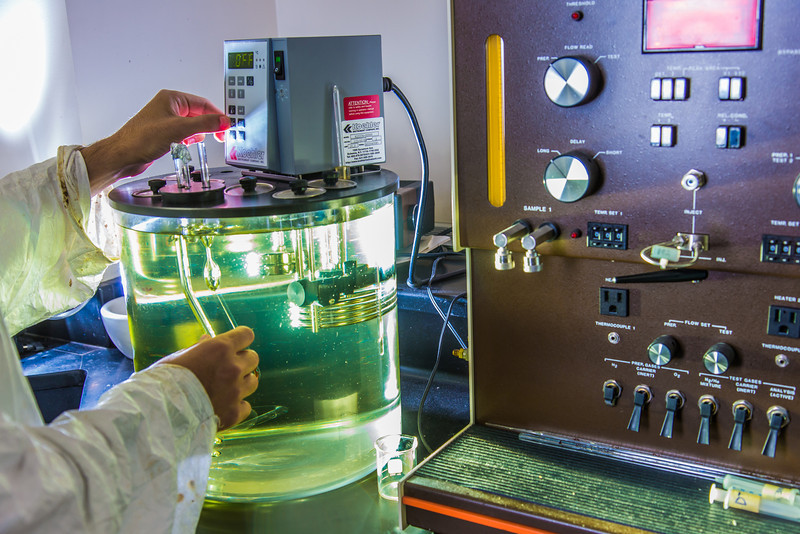 """Graduate student Behnam Zanganeh sets up apparatus for a procedure in UAF's Petroleum Development Lab in the Duckering Building.  <div class=""""ss-paypal-button"""">Filename: AAR-13-3918-180.jpg</div><div class=""""ss-paypal-button-end"""" style=""""""""></div>"""
