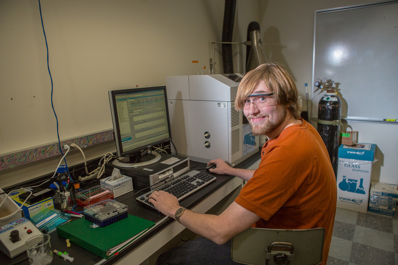 """Chemistry major Simeon Schum enters data in a Reichardt Building lab.  <div class=""""ss-paypal-button"""">Filename: AAR-12-3598-194.jpg</div><div class=""""ss-paypal-button-end"""" style=""""""""></div>"""
