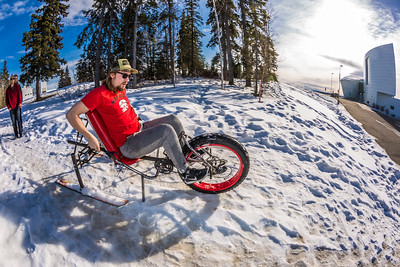 Mechanical engineering major Eric Bookless demonstrates the fat tire ski bike he and two partners designed and built for paraplegic users as their spring 2016 senior design project. The bike is powered by pushing and pulling on the handles.  Filename: AAR-16-4856-79.jpg