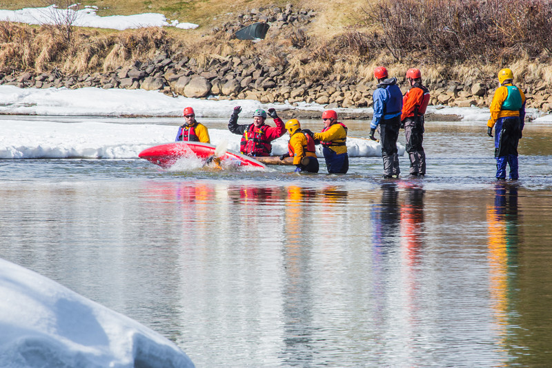 """Dick Rice of Rescue Alaska, with hands up, demonstrates swiftwater rescue and safety techniques to staff members and graduate students from the Water and Environmental Research Center (WERC) and the Institute of Northern Engineering (INE) in the Chena River.  <div class=""""ss-paypal-button"""">Filename: AAR-13-3813-37.jpg</div><div class=""""ss-paypal-button-end"""" style=""""""""></div>"""