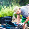 "Carl France with the Alaska Center for Unmanned Aircraft Systems Integration (ACUASI) monitors the flight of an unmanned aerial vehicle from a gravel bar in the upper Chena River. Personnel with ACUASI partnered with the U.S. Fish and Wildlife Service to collect aerial video of the popular stretch of important king salmon spawning habitat.  <div class=""ss-paypal-button"">Filename: AAR-15-4593-288.jpg</div><div class=""ss-paypal-button-end""></div>"