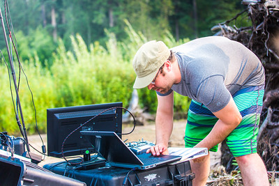 Carl France with the Alaska Center for Unmanned Aircraft Systems Integration (ACUASI) monitors the flight of an unmanned aerial vehicle from a gravel bar in the upper Chena River. Personnel with ACUASI partnered with the U.S. Fish and Wildlife Service to collect aerial video of the popular stretch of important king salmon spawning habitat.  Filename: AAR-15-4593-288.jpg