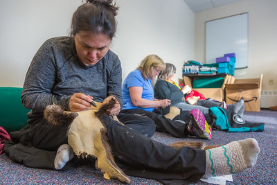 Community members learn how to make authentic beaver hats during an evening class at UAF's Chukchi Campus in Kotzebue.  Filename: AAR-16-4863-086.jpg