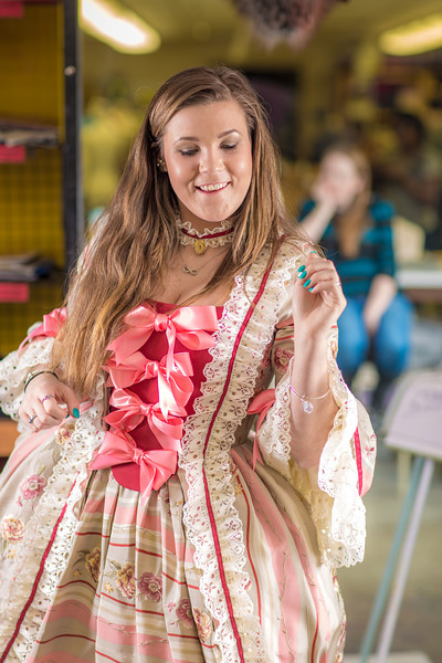 """Theater major Katrina Kuharich tries out some dance moves while wearing  her dress for the Theatre UAF production of Tartuffe during a fitting in the department's costume shop.  <div class=""""ss-paypal-button"""">Filename: AAR-14-4104-138.jpg</div><div class=""""ss-paypal-button-end"""" style=""""""""></div>"""