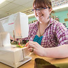 """Student employee and anthropology major Shealyn Golden works at her job in the Theatre UAF costume shop.  <div class=""""ss-paypal-button"""">Filename: AAR-14-4104-191.jpg</div><div class=""""ss-paypal-button-end"""" style=""""""""></div>"""