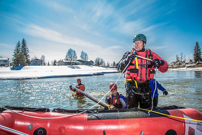 Dick Rice with Rescue Alaska, front, demonstrates swiftwater rescue and safety techniques to staff members and graduate students from the Water and Environmental Research Center (WERC) and the Institute of Northern Engineering (INE) in the Chena River.  Filename: AAR-13-3813-164.jpg
