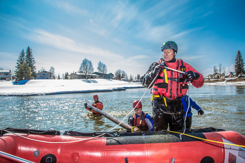 """Dick Rice with Rescue Alaska, front, demonstrates swiftwater rescue and safety techniques to staff members and graduate students from the Water and Environmental Research Center (WERC) and the Institute of Northern Engineering (INE) in the Chena River.  <div class=""""ss-paypal-button"""">Filename: AAR-13-3813-164.jpg</div><div class=""""ss-paypal-button-end"""" style=""""""""></div>"""