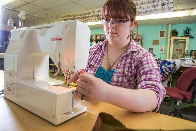 "Student employee and anthropology major Shealyn Golden works at her job in the Theatre UAF costume shop.  <div class=""ss-paypal-button"">Filename: AAR-14-4104-188.jpg</div><div class=""ss-paypal-button-end"" style=""""></div>"