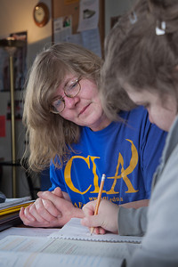 Lawana Pacheco, left, a tutor with UAF's Student Support Services, works with a student during a session in the SSS study lounge in the Gruening Building.  Filename: AAR-12-3285-022.jpg