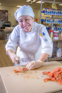 Jenevie Star Burgess prepares smokes salmon to serve at lunch at CTC's culinary arts kitchen in the Hutchison Center.  Filename: AAR-13-3811-19.jpg
