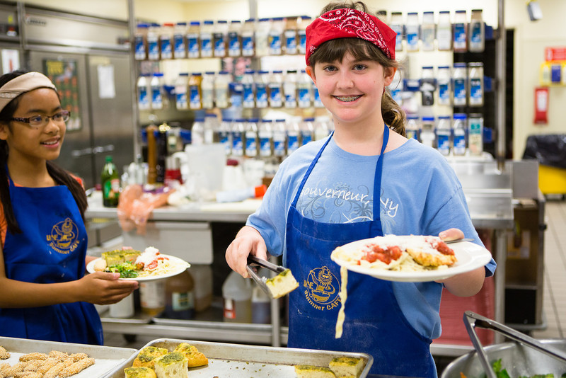 """Students from Summer Sessions' Café Tween pose for a photograph after cooking Italian cuisine at Hutchinson's kitchen.  <div class=""""ss-paypal-button"""">Filename: AAR-12-3432-18.jpg</div><div class=""""ss-paypal-button-end"""" style=""""""""></div>"""