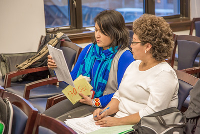 Barbara Blake, left, assistant professor of Alaska Native Studies and Rural Development, reads prepared testimony written by undergraduate Vivian Shade from Alaknagik during a weeklong seminar on understanding the legislative process in Juneau.  Filename: AAR-14-4056-43.jpg