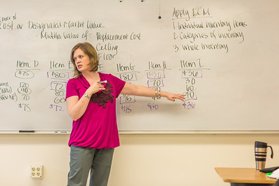 Amy Cooper lectures to her intermediate accounting students in a Duckering Building classroom.  Filename: AAR-14-4112-118.jpg