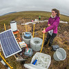 "Ludda Ludwig, a Ph.D. candidate with UAF's College of Natural Science and Mathematics, collects water samples from a research site near the headwaters of the Kuparuk River on Alaska's North Slope.  <div class=""ss-paypal-button"">Filename: AAR-14-4217-077.jpg</div><div class=""ss-paypal-button-end""></div>"