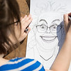 "Visual Arts Academy cartooning class draws outside on Constitution Park on a sunny day.  <div class=""ss-paypal-button"">Filename: AAR-12-3430-16.jpg</div><div class=""ss-paypal-button-end"" style=""""></div>"