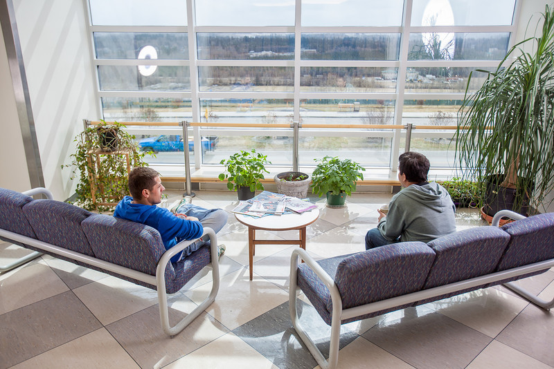 """Ibrahim Ilhan, left, and Nilesh Chandrakant Dixit hold a discussion in the third floor lobby of the Reichardt Building on the Fairbanks campus.  <div class=""""ss-paypal-button"""">Filename: AAR-12-3386-09.jpg</div><div class=""""ss-paypal-button-end"""" style=""""""""></div>"""