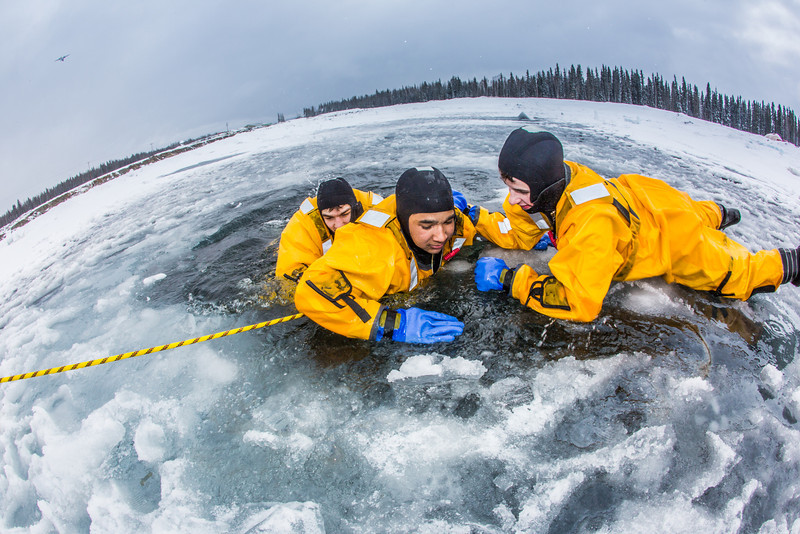 """Student firefighters practice cold-water rescue techniques at a pond near the Fairbanks campus.  <div class=""""ss-paypal-button"""">Filename: AAR-13-3797-26.jpg</div><div class=""""ss-paypal-button-end"""" style=""""""""></div>"""