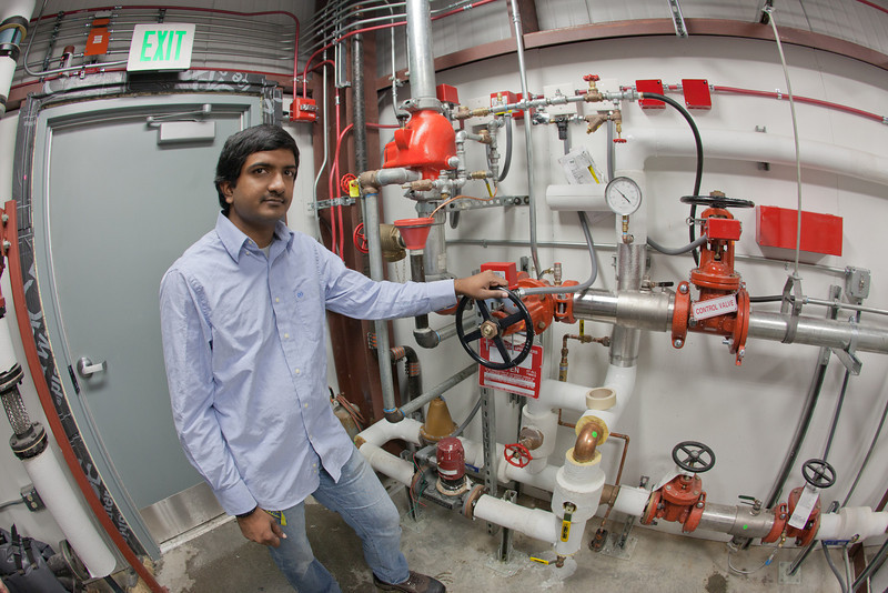 """Graduate student Eshwar Chukkapalli works in the control room of the rearch facility for the Alaska Center for Energy and Power.  <div class=""""ss-paypal-button"""">Filename: AAR-11-3245-399.jpg</div><div class=""""ss-paypal-button-end"""" style=""""""""></div>"""