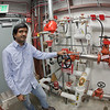 "Graduate student Eshwar Chukkapalli works in the control room of the rearch facility for the Alaska Center for Energy and Power.  <div class=""ss-paypal-button"">Filename: AAR-11-3245-399.jpg</div><div class=""ss-paypal-button-end"" style=""""></div>"
