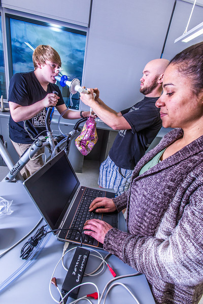 """Chris Wilson works out on a stair step machine while Ivan Lien and Marisol Bastiani collect data measuring his respiration during a human physiology lab in the Murie Building.  <div class=""""ss-paypal-button"""">Filename: AAR-13-3983-49.jpg</div><div class=""""ss-paypal-button-end"""" style=""""""""></div>"""