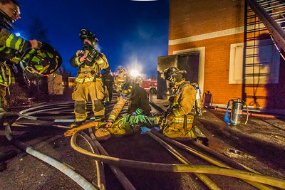 Student fire fighters with the UFD practice evacuation and CPR techniques during a live training drill at the Fairbanks Fire Training Center.  Filename: AAR-13-3978-147.jpg