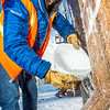 "Engineering major Ryan Cudo pours water which will freeze and help stablize the vertical supports during the raising of the 2013 ice arch in Cornerstone Plaza on the Fairbanks campus. Students this year built the structure out of a mixture of ice and sawdust, which is many times stronger than concrete.  <div class=""ss-paypal-button"">Filename: AAR-13-3736-102.jpg</div><div class=""ss-paypal-button-end"" style=""""></div>"