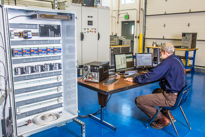 """Research technician David Light works in one of the modules in the Alaska Center for Energy and Power Technology Center.  <div class=""""ss-paypal-button"""">Filename: AAR-12-3479-013.jpg</div><div class=""""ss-paypal-button-end"""" style=""""""""></div>"""